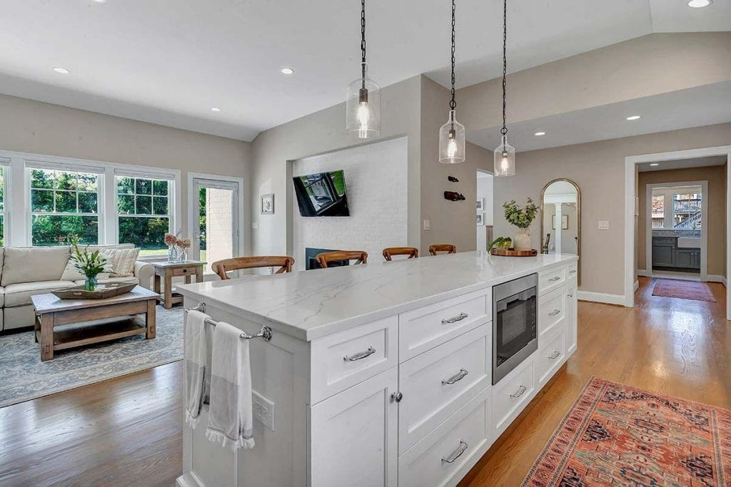 Coastal Renovation: Open Kitchen and Living Room with Custom Dean Cabinetry.